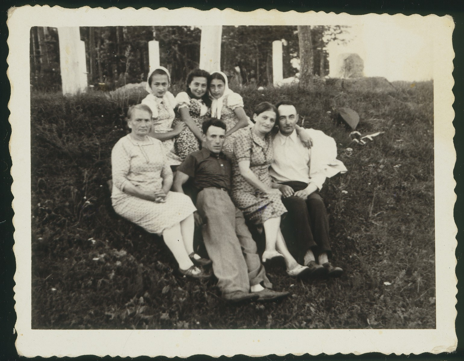 Portrait of the Michalowski family taken in a park.  Sitting in the front row, right to left:  Maneh Michalowski, Bluma Zlotnik Michalowski, unknown, Hayya Fradl Zlotnik Broide (Bluma's sister). Back row: the Michalowski children.  Bluma and her sister Hayya Fradl were murdered by Lithuanian collaborators as they tried to escape the September 1941 massacre.  Maneh Michalowski and all the Michalowski children were murdered in the September 1941 massacre.