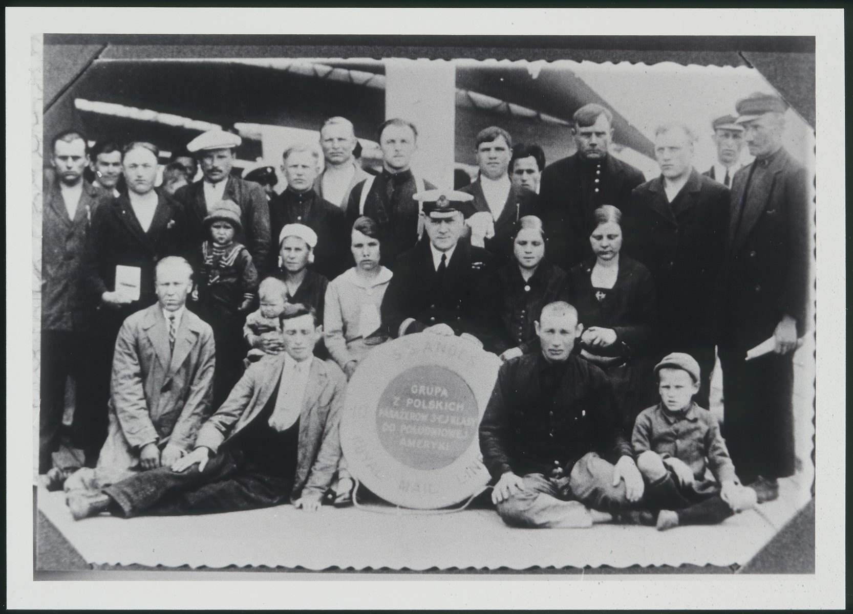 The father of Avraham Aviel poses on the deck of a ship along with other passengers while on route to South America.
