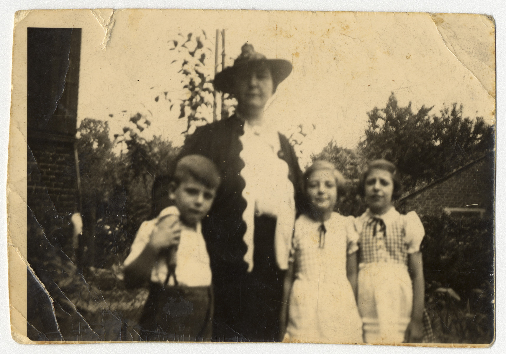 Portrait of Paula Herz Kahn (aunt of the donor) and her three children Hilda, Helga and Eric.    All of them perished in the Holocaust.