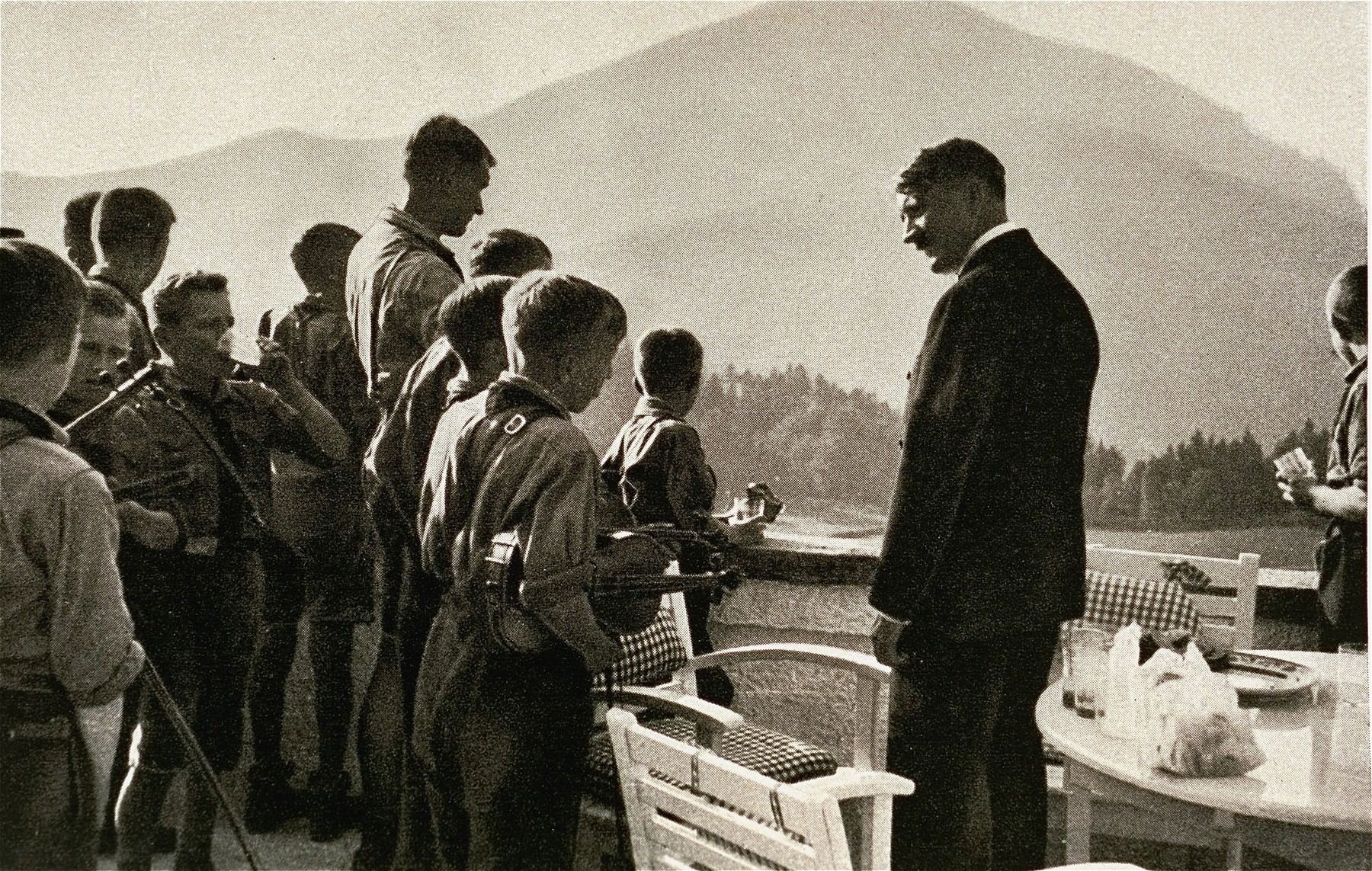 Adolf Hitler meets with members of a Hitler Youth orchestra at the Berghof.