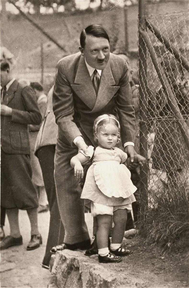 Adolf Hitler with an unidentified German child.