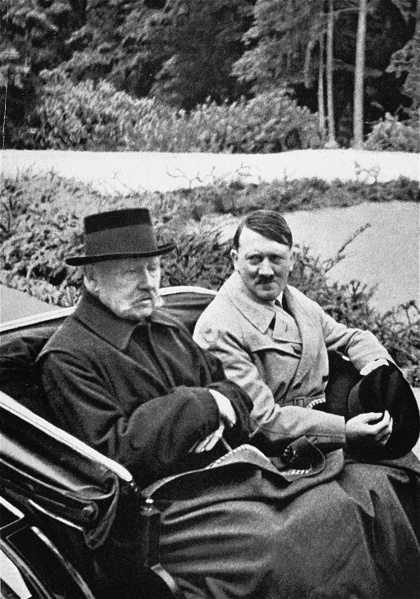 German President Paul von Hindenburg rides in an open car with Adolf Hitler, the newly appointed Chancellor.