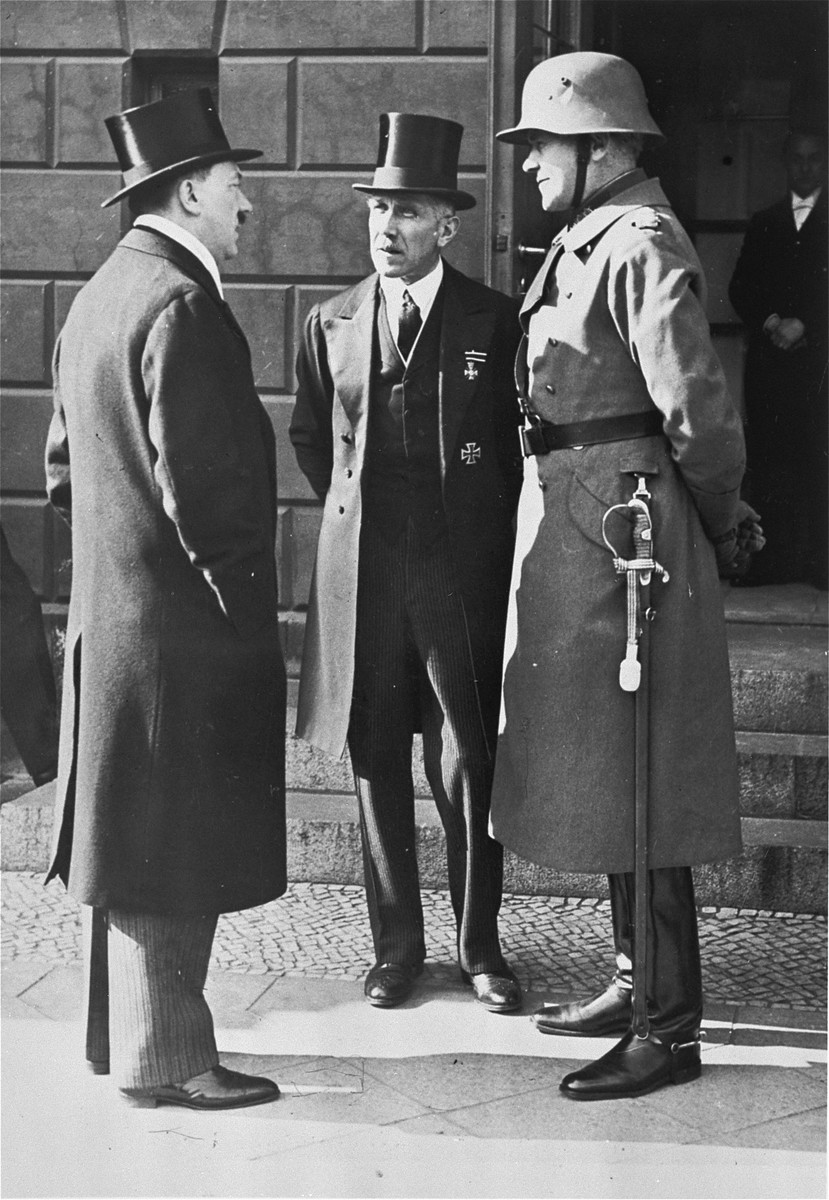 Chancellor Hitler, Vice Chancellor Von Papen and Defense Minister Von Blomberg waiting in front of the opera for the Reichs President on the German national day of mourning.