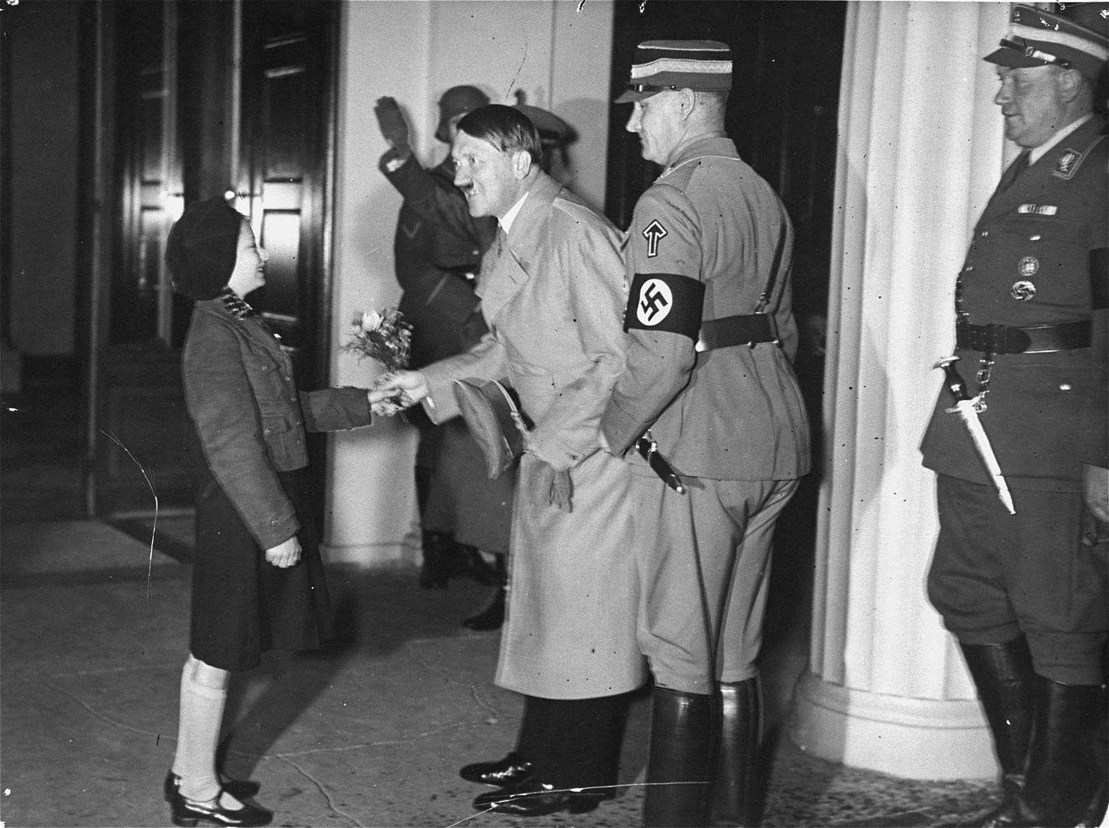 Adolf Hitler greets the daughter of General Karl-Siegfried Litzmann at a Nazi Party convention.