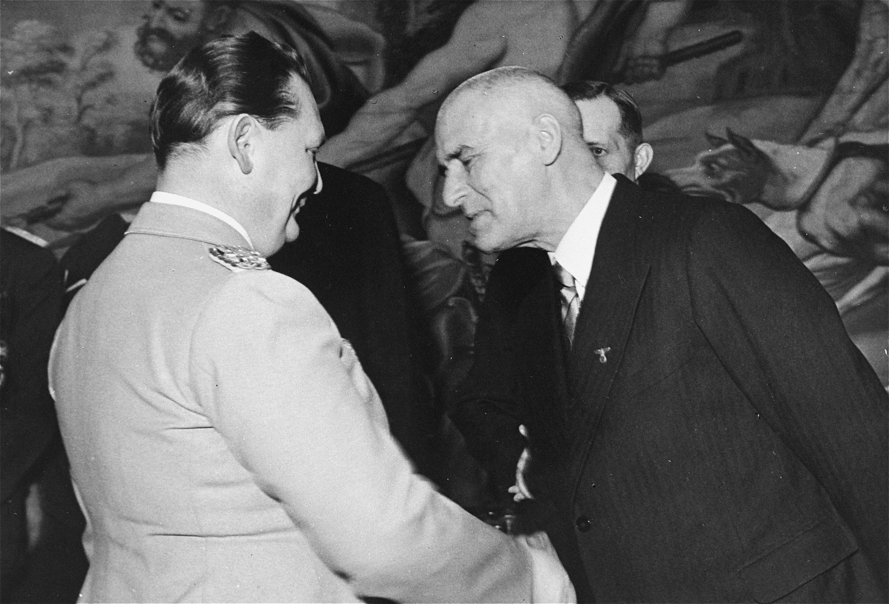 Reich Minister Hermann Goering greets Wilhelm Frick, the German Minister of the Interior, at an official public function.