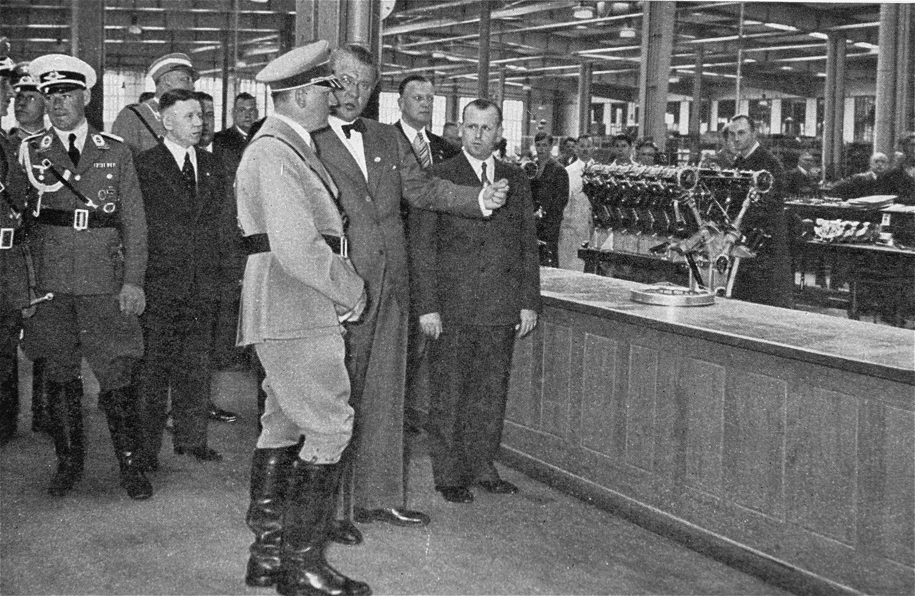 Franz-Josef Popp, Director General of Bayrischen Motorenwerken (BMW) gives Adolf Hitler a tour of a factory.
