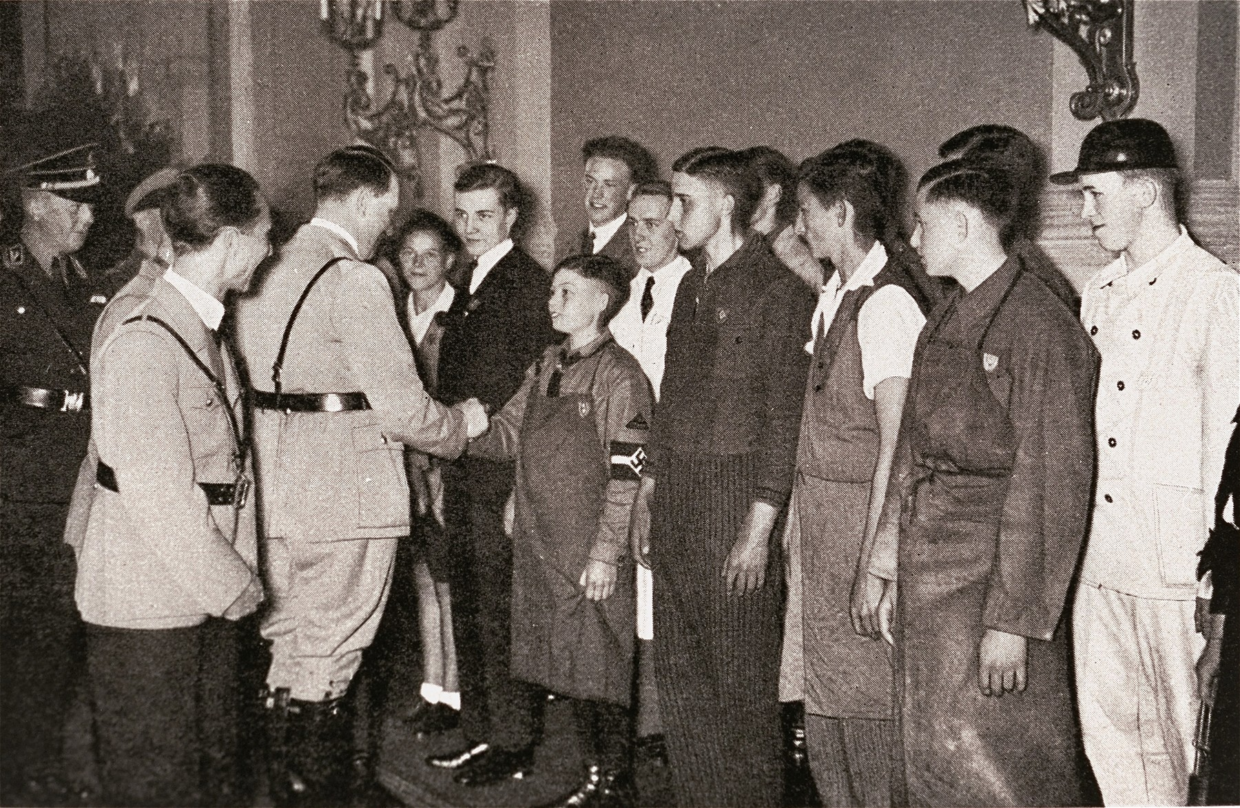 Adolf Hitler greets members of the Arbeiterjugend (Youth Workers) in the Reich chancellery.