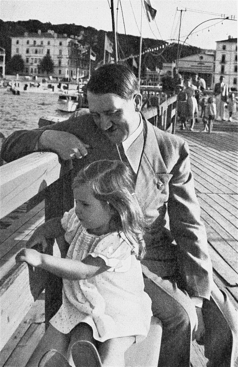 Hitler plays with young Helga Goebbels at the waterfront.