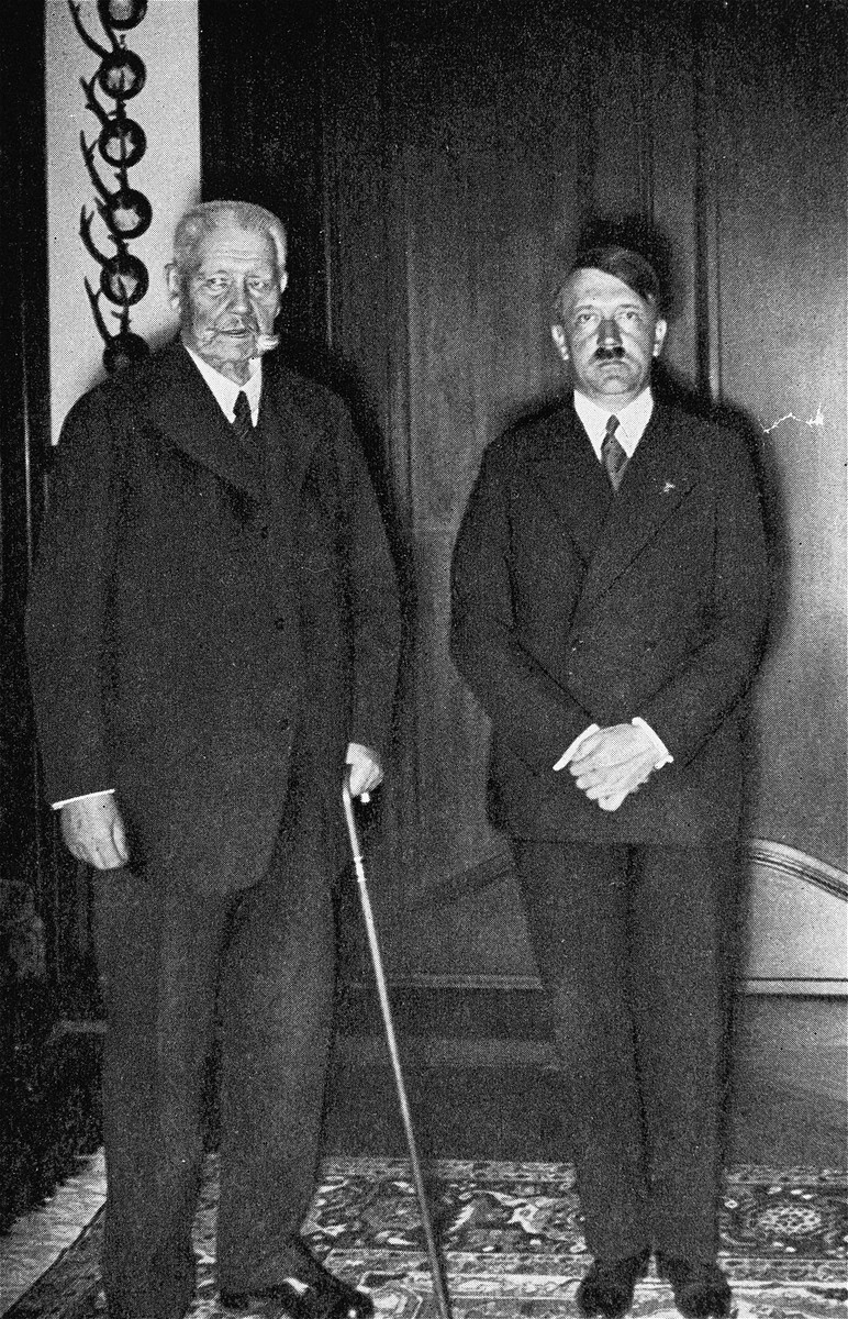 Reich President Paul von Hindenburg poses with Reich Chancellor Adolf Hitler.