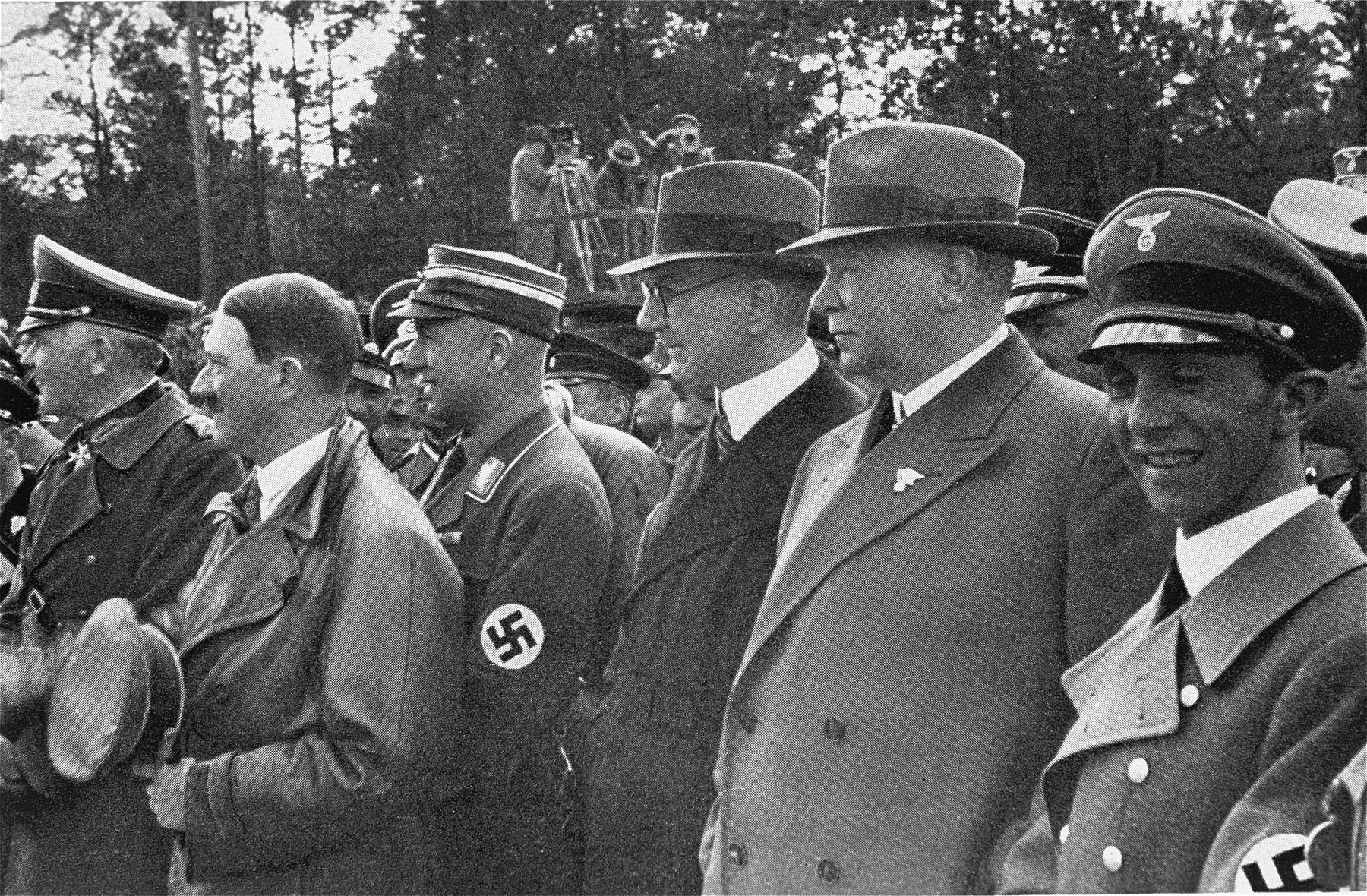 Adolf Hitler attends the opening of the autobahn route between Frankfurt and Darmstadt.  Pictured from left to right are: Werner von Blomberg, Hitler, Fritz Todt, Hjalmar Schacht, Julius Dorpmueller, and Joseph Goebbels.