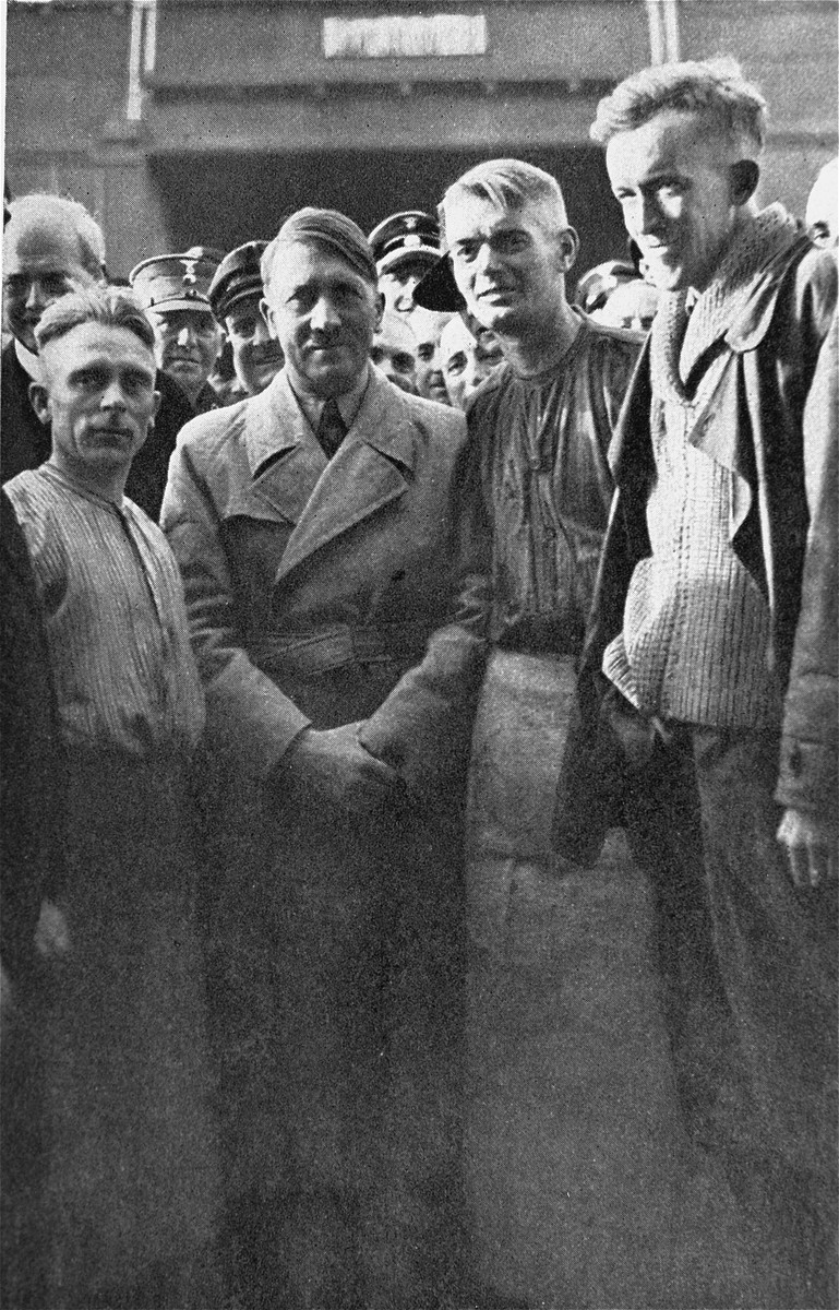 Adolf Hitler visits German workers at a Siemens factory.