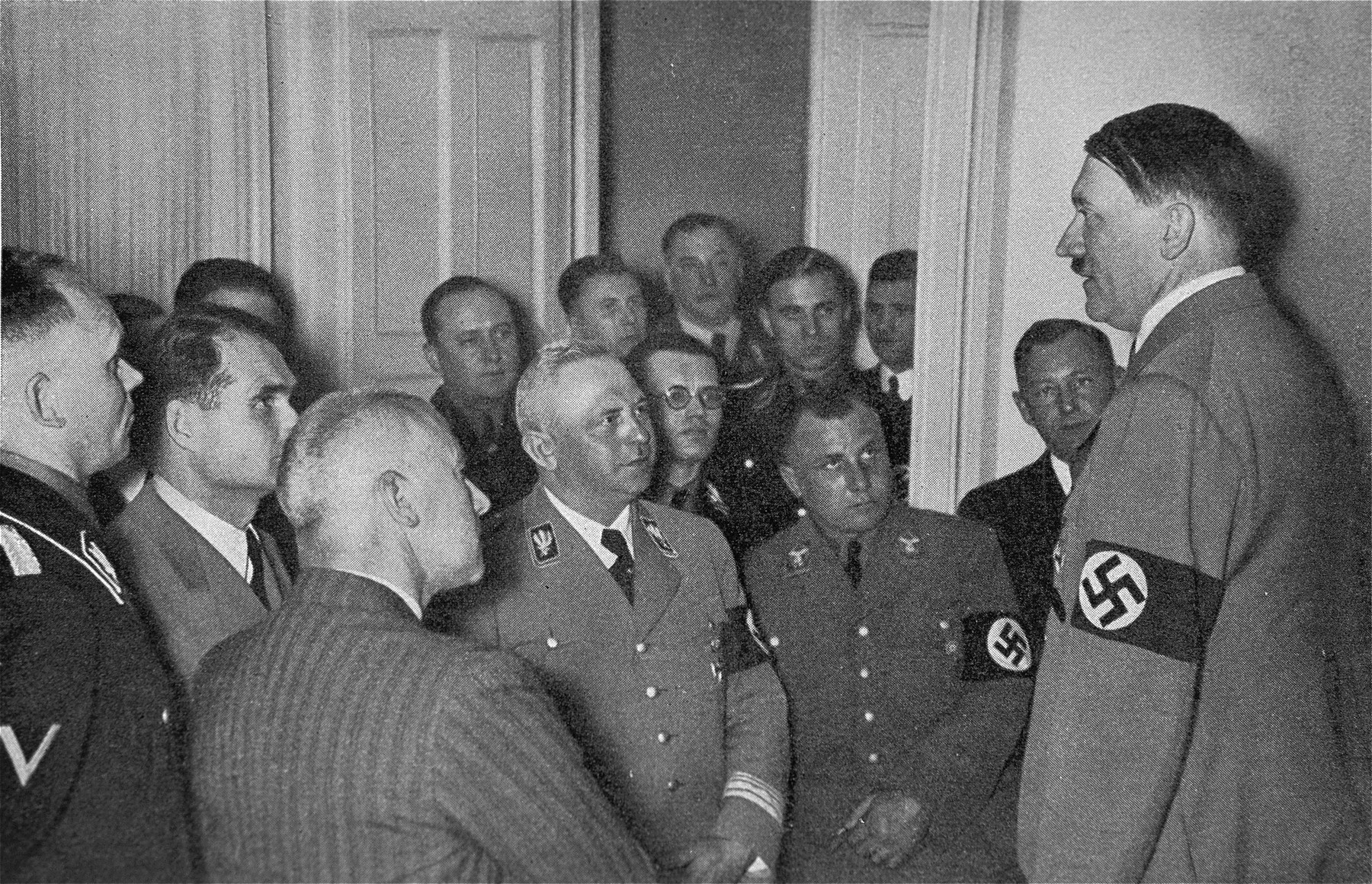 Adolf Hitler speaks to his closest associates on the evening of the Reichstag elections of March 29, 1936.