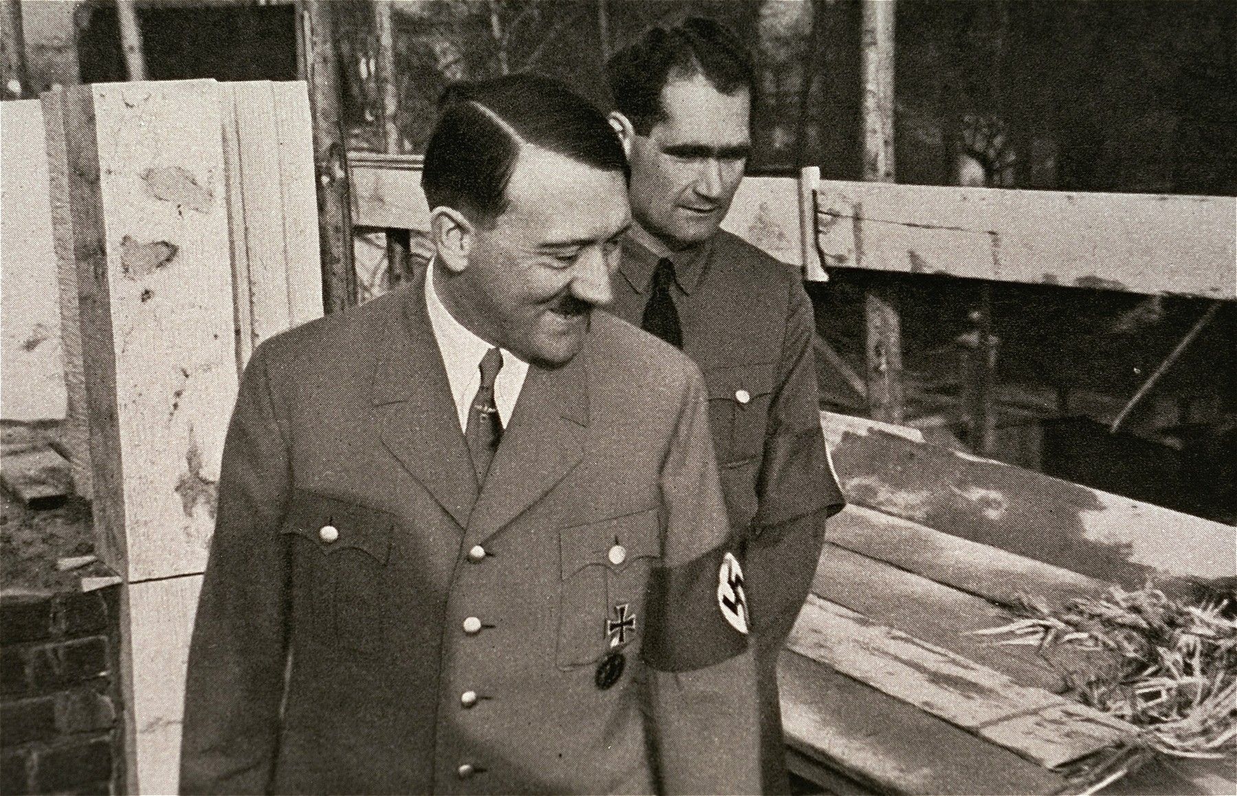 Hitler and Rudolf Hess inspecting the building of the Fuehrer's house in Munich.