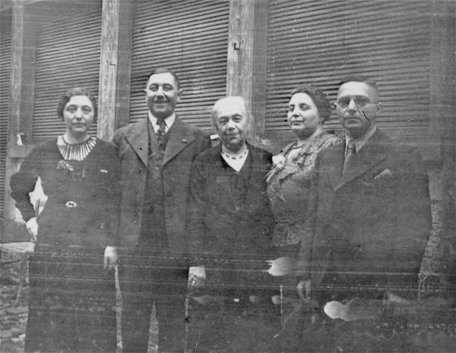 Members of the Wachenheimer family pose in front of their dry goods store.    Pictured from left to right are: Sophie Wachenheimer Strauss, Oskar Wachenheimer, Lina Weissman Wachenheimer, Hilda Wachenheimer Weil and Hugo Wachenheimer.  The entire family was deported to the Gurs internment camp on October 22, 1940.