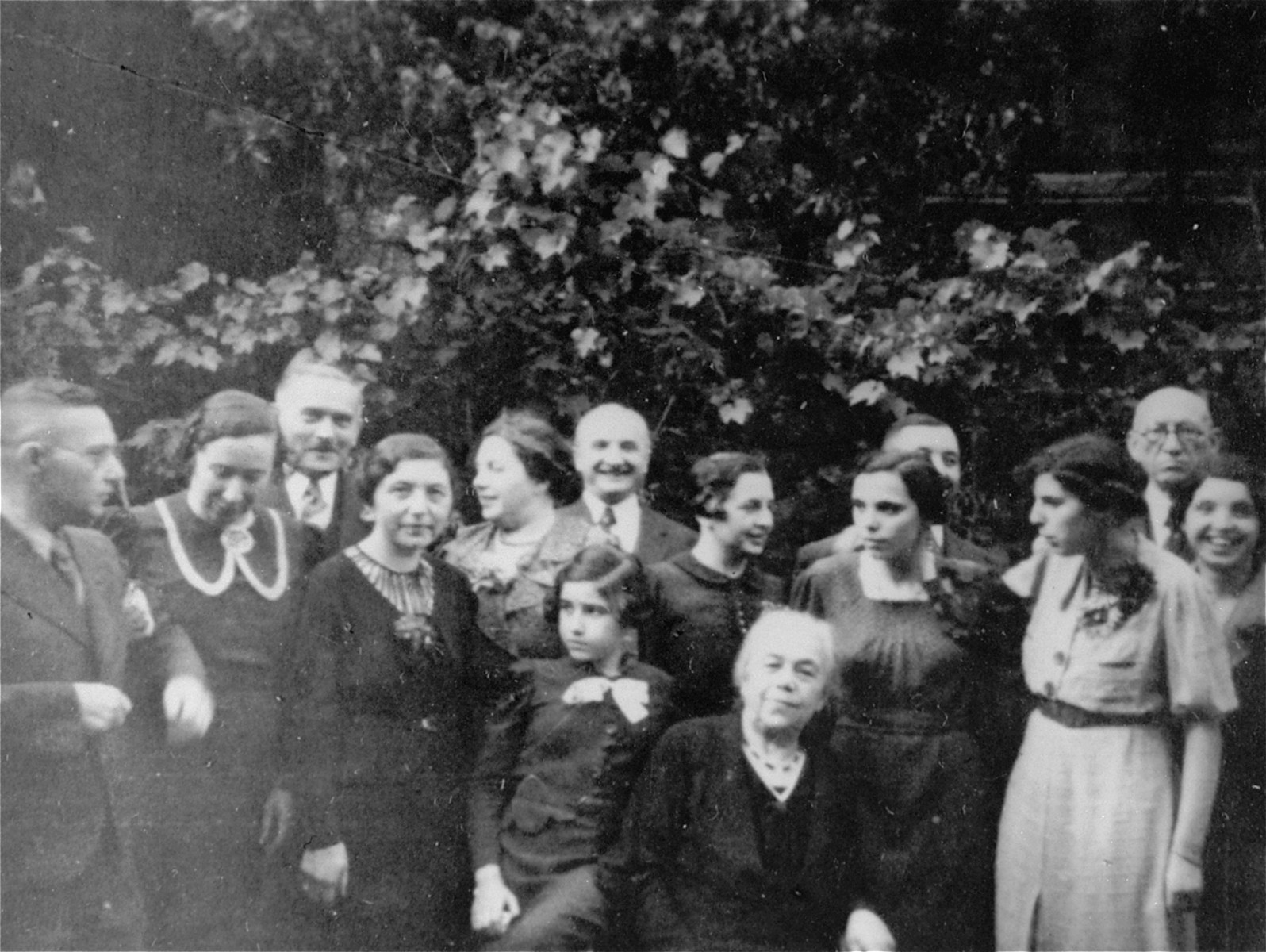 Group portrait of the Wachenheimer family taken on the 75th birthday of Lina Weissmann Wachenheimer.   Hedy Wachenheimer is seated next to her grandmother, Lina Weissmann Wachenheimer.