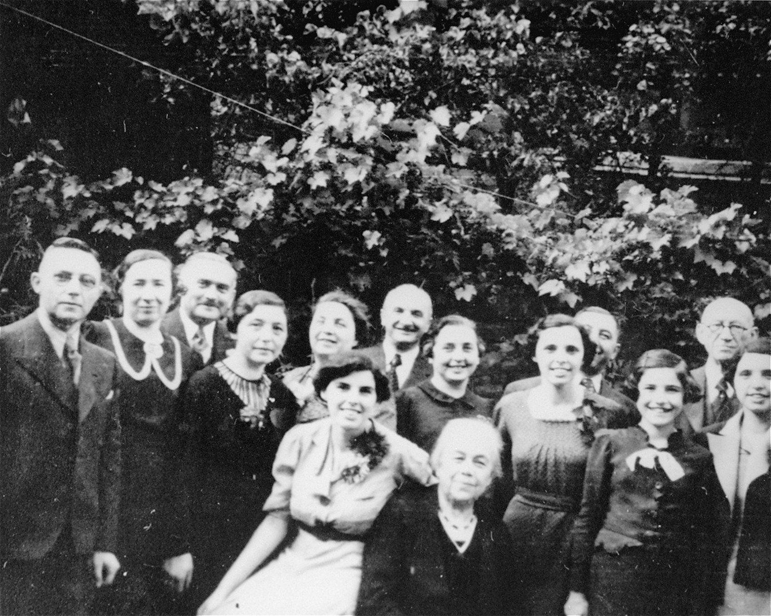 Group portrait of the Wachenheimer family taken on the 75th birthday of Lina Weissmann Wachenheimer.   Hedy Wachenheimer, the granddaughter of Lina Weissmann Wachenheimer, is pictured second on the right.