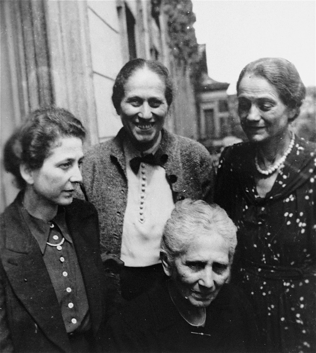 Four Jewish women pose on the balcony of their apartment located on Klopstockstrasse 18 in the Tiergarten, Berlin.   Pictured standing from the left are: Lydia Ellgass,  Kaethe (Gottschalk) Knipfer and Nanny (Gottschalk) Lewin.  Bertha (Wolffberg) Gottschalk is in the front.