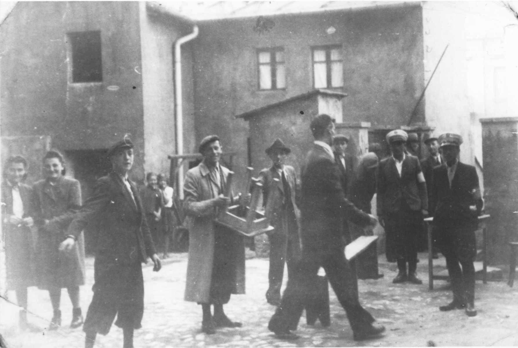 Street scene with Jewish police in the Bedzin ghetto.  Among those pictured is Hanka Ehrlich (second from the left).
