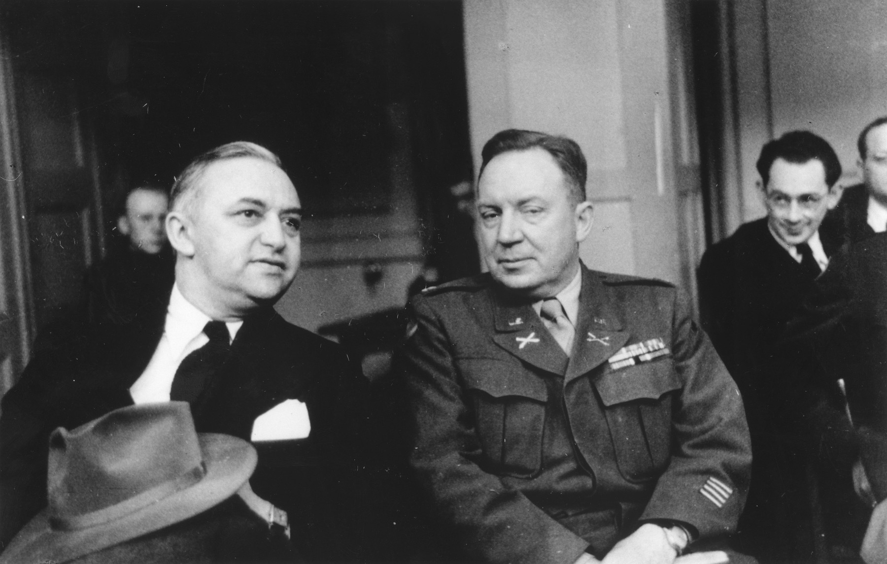 Rabbi Philip Bernstein, adviser on Jewish Affairs to the commander of the US forces in Europe, in conversation with an American military officer.