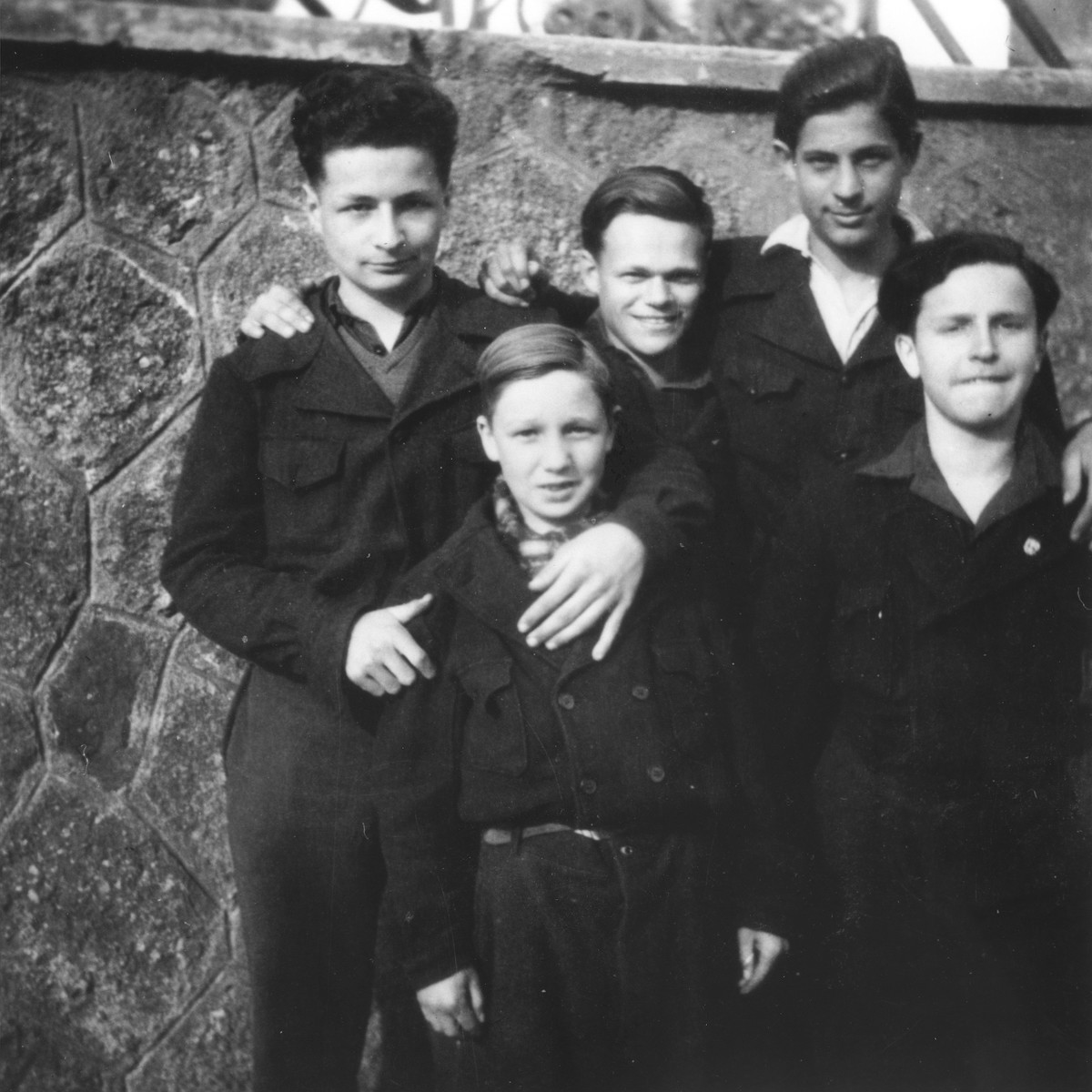 Five members of the Vichy fascist youth movement, Moisson Nouvelles, at its national center in St. Junien.    Three of the boys are hidden Jews, placed at the center by the OSI (Oeuvre de Secours aux Enfants).  The donor, Walter Karliner, is pictured in the middle of the back row.