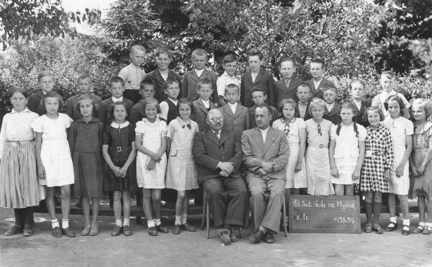Group portrait of the fifth grade class at the Myjava public school.  Among those pictured is Magdalena Beck (front row, fourth from the right).