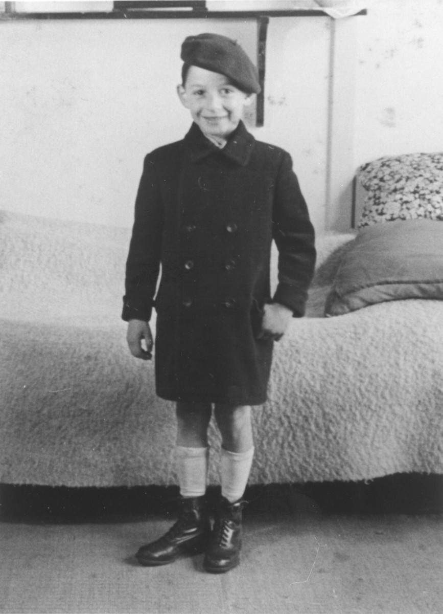 Michael Fink poses in his family's living quarters in the Westerbork internment camp.