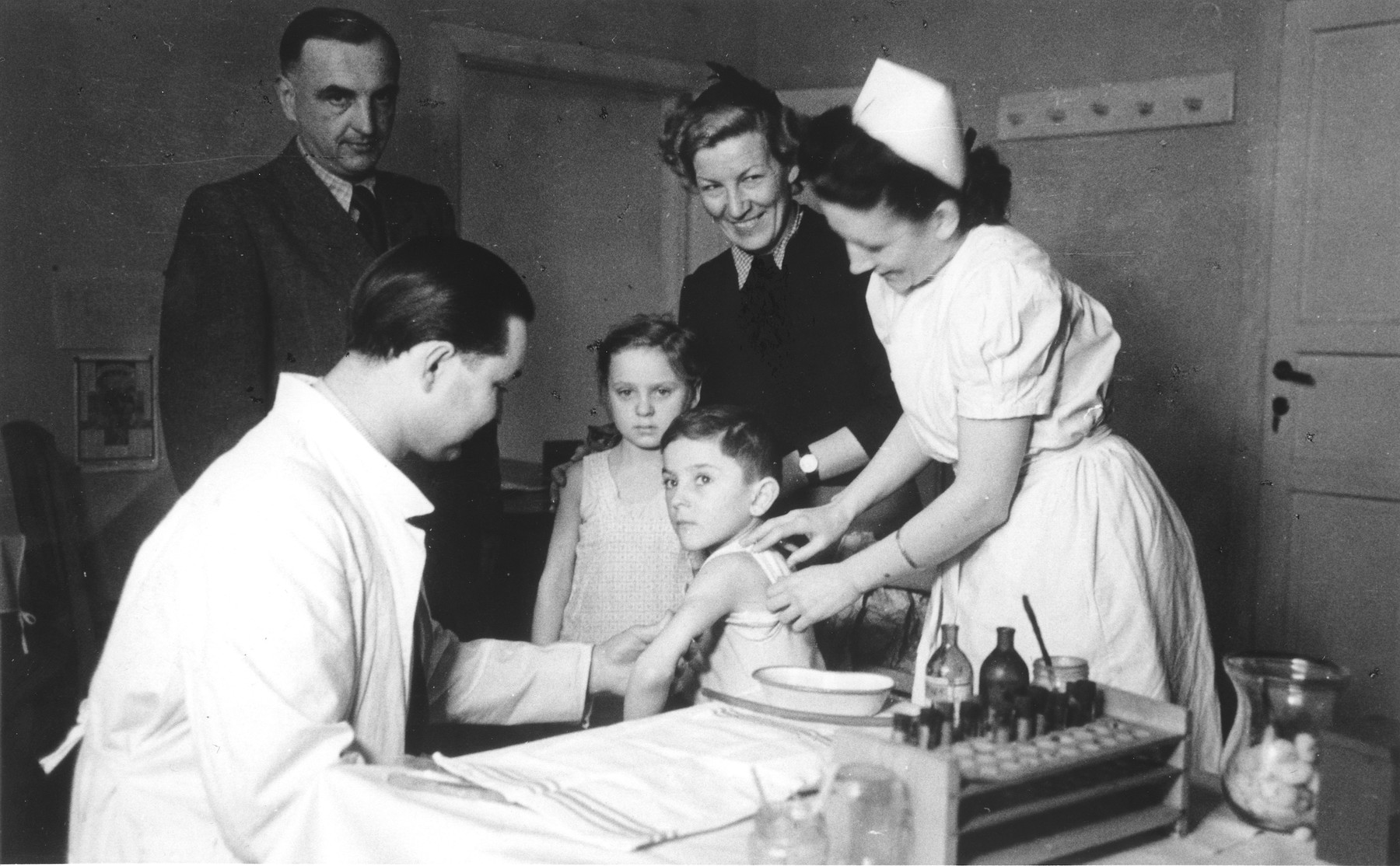 Children receive medical examinations in the Bad Schallerbach home for displaced children.