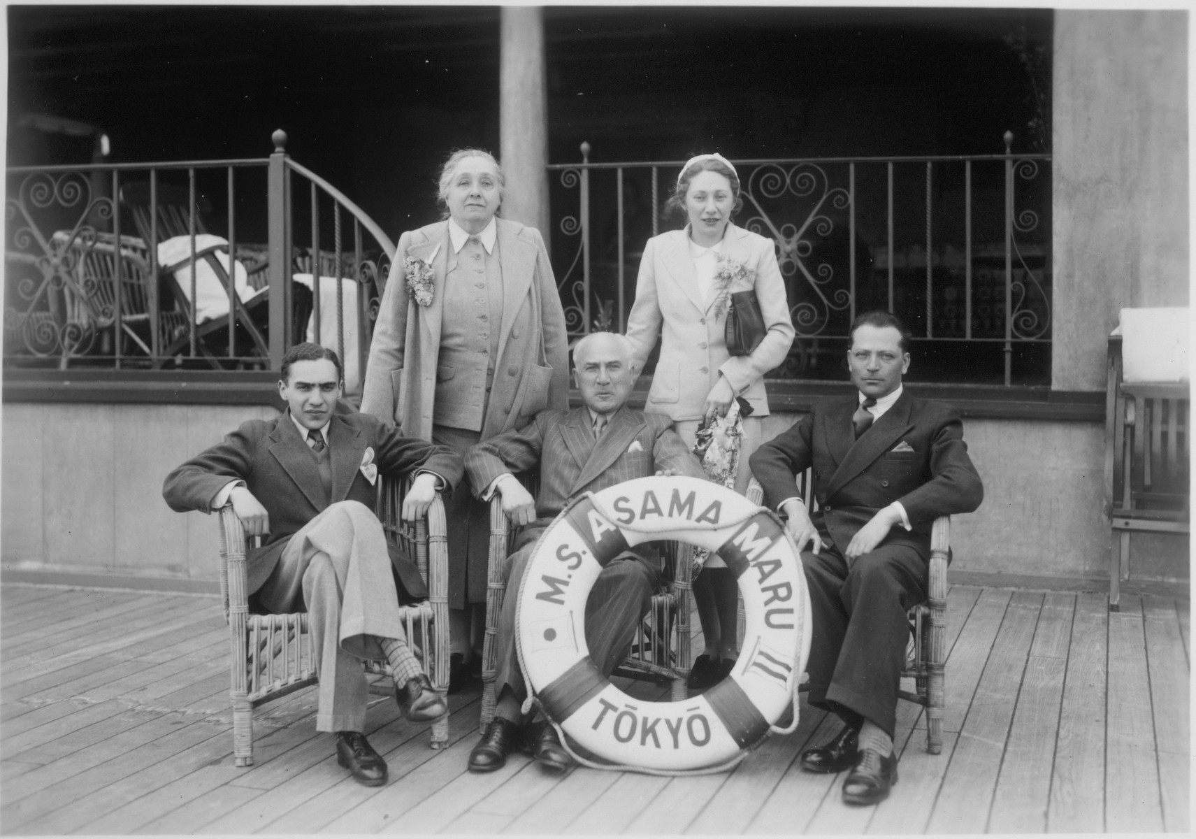 A group of Jewish refugees gather on the deck of the Asama Maru en toute from Japan to Canada.  Pictured in the front row, from left to right: Bronislaw and Zelik Honigberg, and Salomon Fishaut.   In the back row, from left to right: Maryla Honigberg and Paulina (Honigberg) Fishaut.