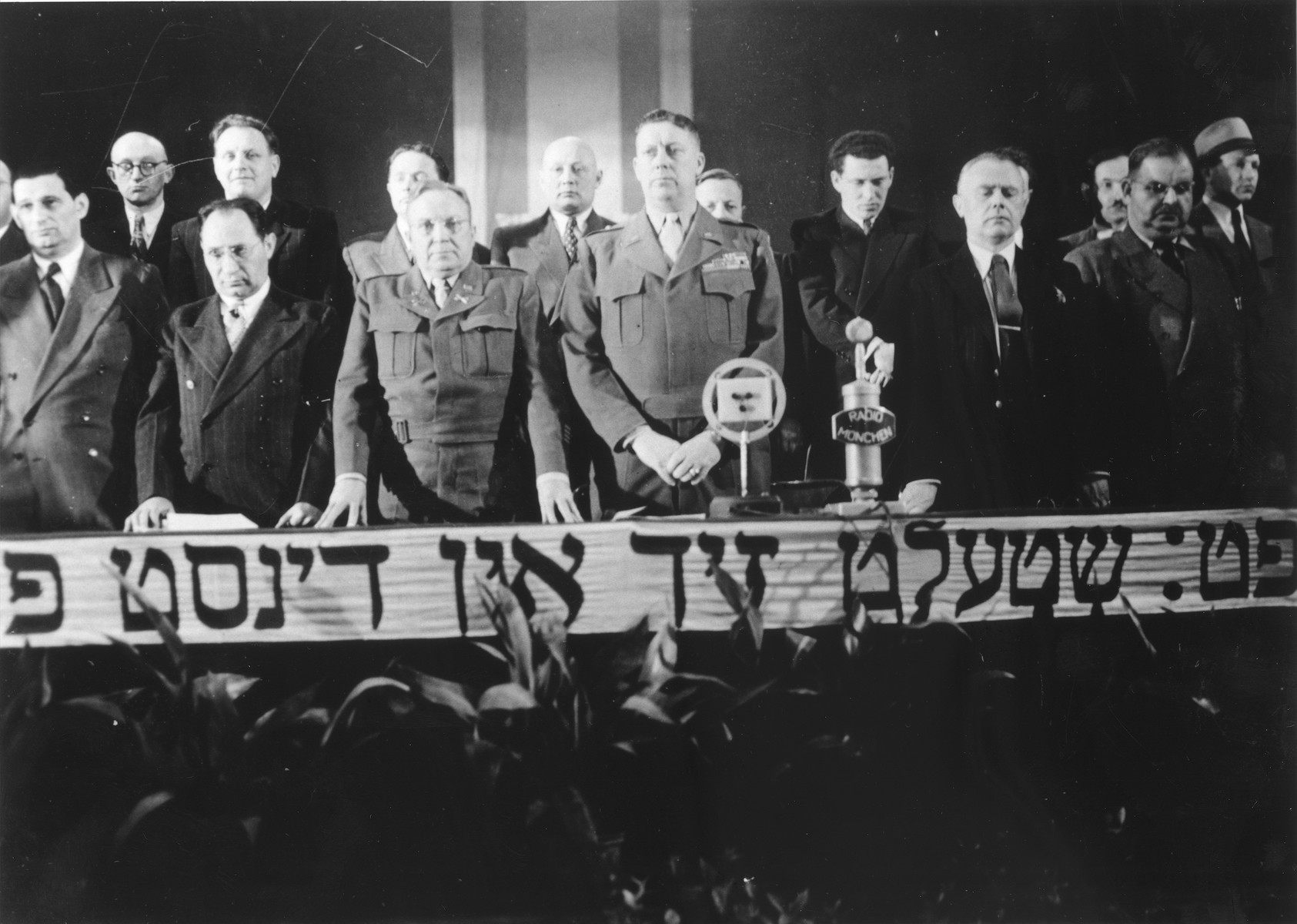 Speakers at the dais at the Third Conference of Liberated Jews in the US Zone of Germany.  Among those pictured is Philipp Auerbach (front row, right) and Joseph J. Schwartz (front row, left).