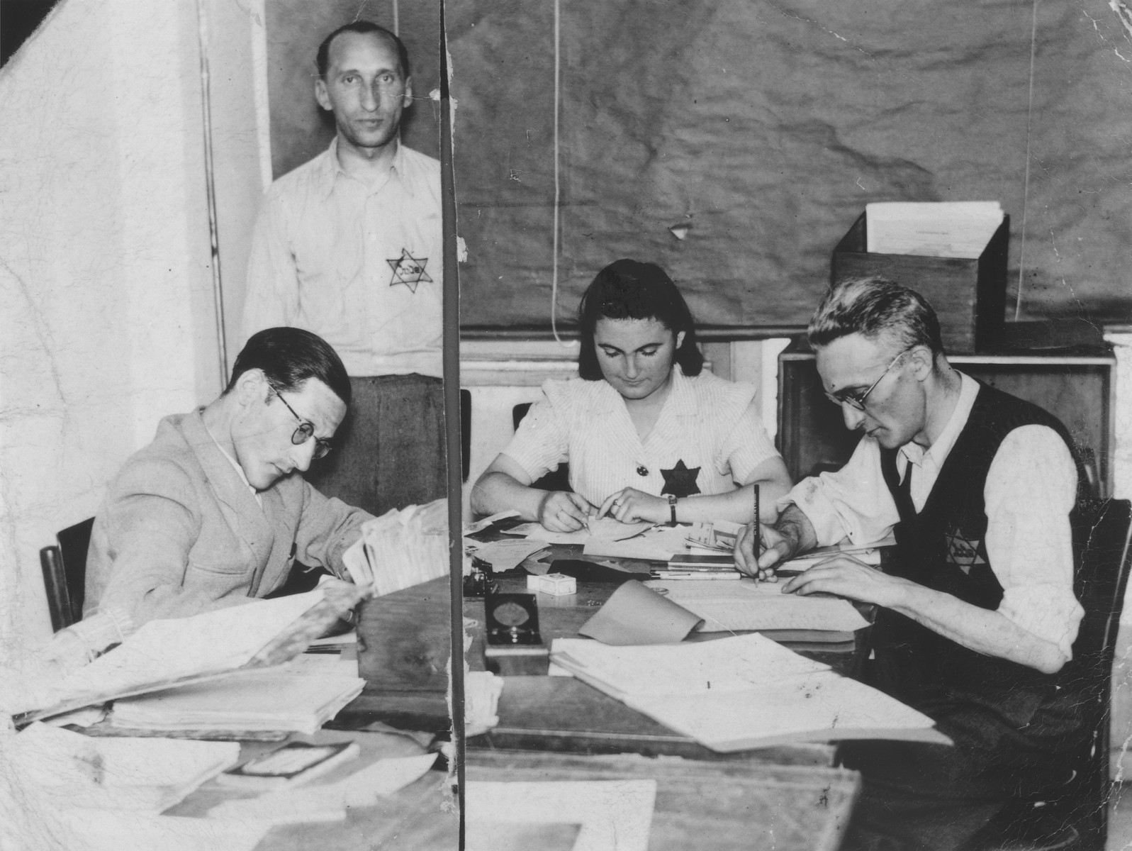 Four employees work in the office of the Leopold Michatz garment factory in the Bedzin ghetto.  Pictured from left to right are Natek Aleksandrowicz, Kahane, Hanka Granek and Hercko Brukner.