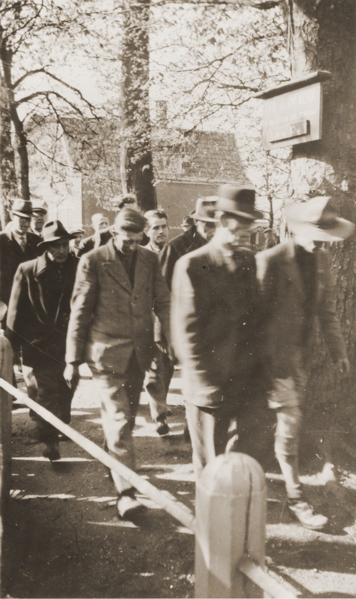 Dutch police allow imprisoned collaborators and fascist party (NSB) members to get some fresh air before returning them to confinement in a municipal building in Eibergen.
