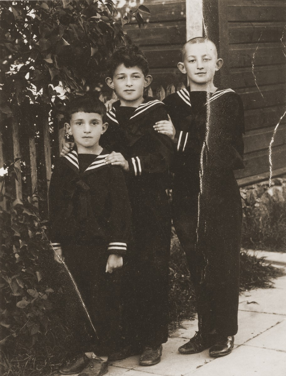 Three Jewish brothers pose in sailor suits.  Pictured from right to left are; Zvi Hirsch; Joseph and Ephraim Harmatz.