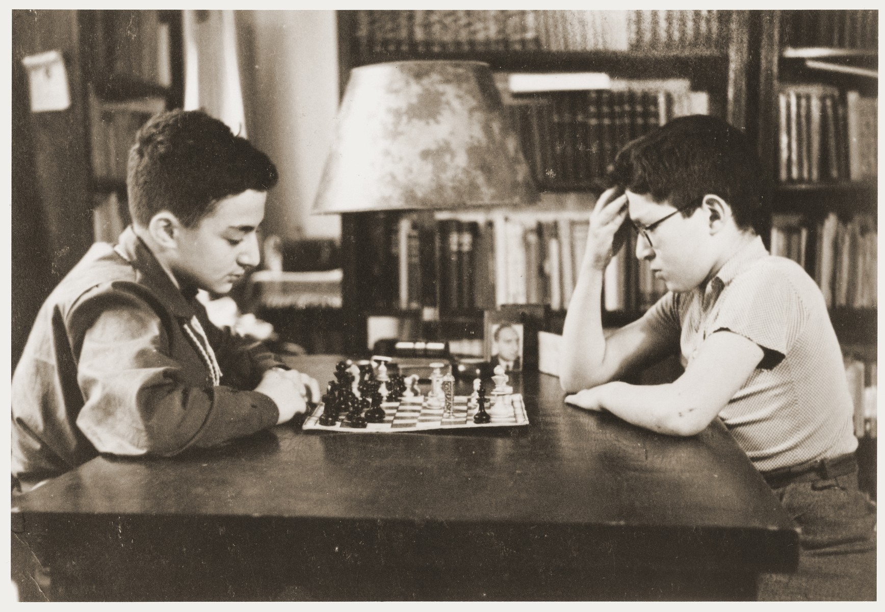 Amos and Binyamin Rabinovitch playing chess in the family house on Gedimino Street.