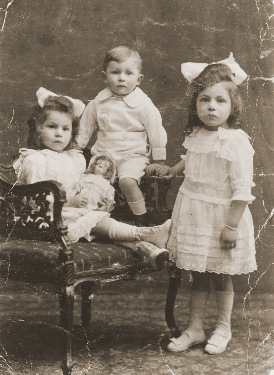 Studio portrait of the three oldest children of Louis and Ida Meijer.  Pictured from left to right are: Bettie, Michel and Johanna Meijer.  All were killed during the Holocaust.