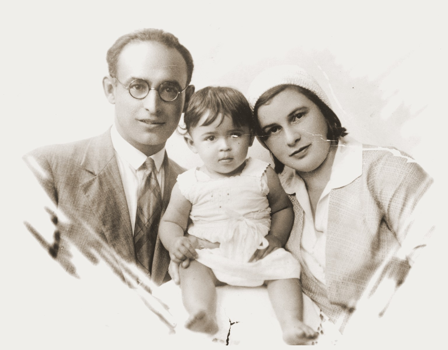 Portrait of Helen, age one, and her parents Tova and Izik (Yitzchak) Verblunsky.