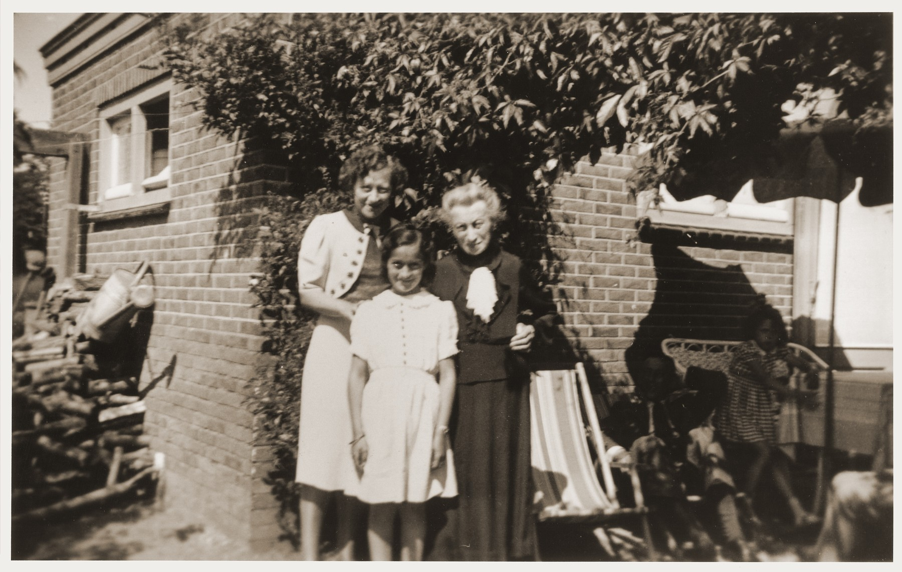 Suse and Kate Grunbaum stand beside Kate's mother, Frieda Kahn.    Frieda joined her family in Holland in 1941, and she committed suicide two days before the family was supposed to go into hiding.  She had been extremely ill and realized she could not survive the conditions in hiding without endangering the rest of the family.