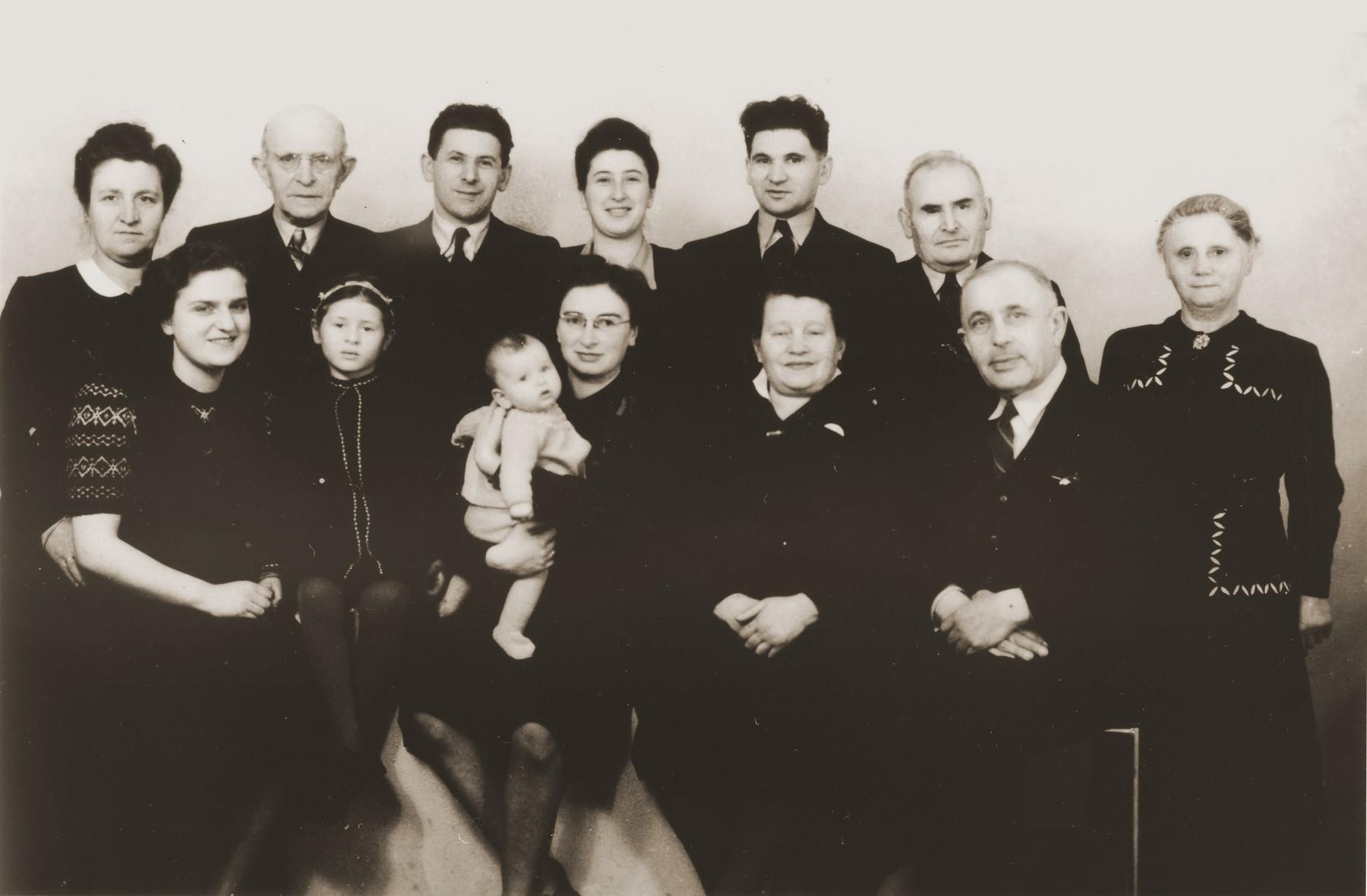 Group portrait of members of the Jewish community of Eibergen in 1947.  Pictured in the front row from left to right are: Bep Menco; Betty Rosenbaum; Nora de Jong Zion holding her daughter, Sera Elizabeth; Jenny Frank Silberberg; Jenny's husband.  In the back row from left to right are: Fie van Gelder Menco; Jenny's brother-in-law; Julius Zion; Bep Meijer; Sallie Zion; Lehman van Gelder; Anna van Gelder.