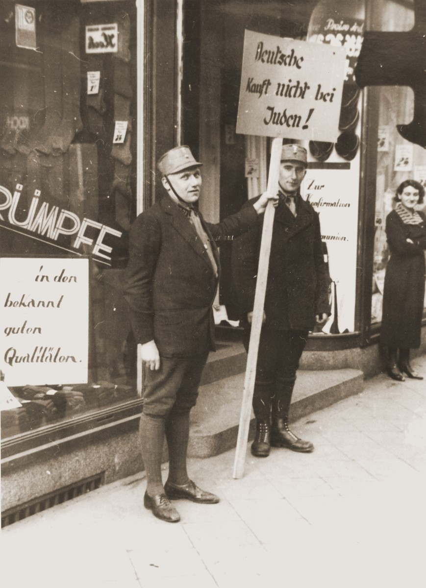Members of the SA block the entrance to the Jewish-owned Erwege store on Fackelstrasse to enforce the April 1 boycott of Jewish businesses.