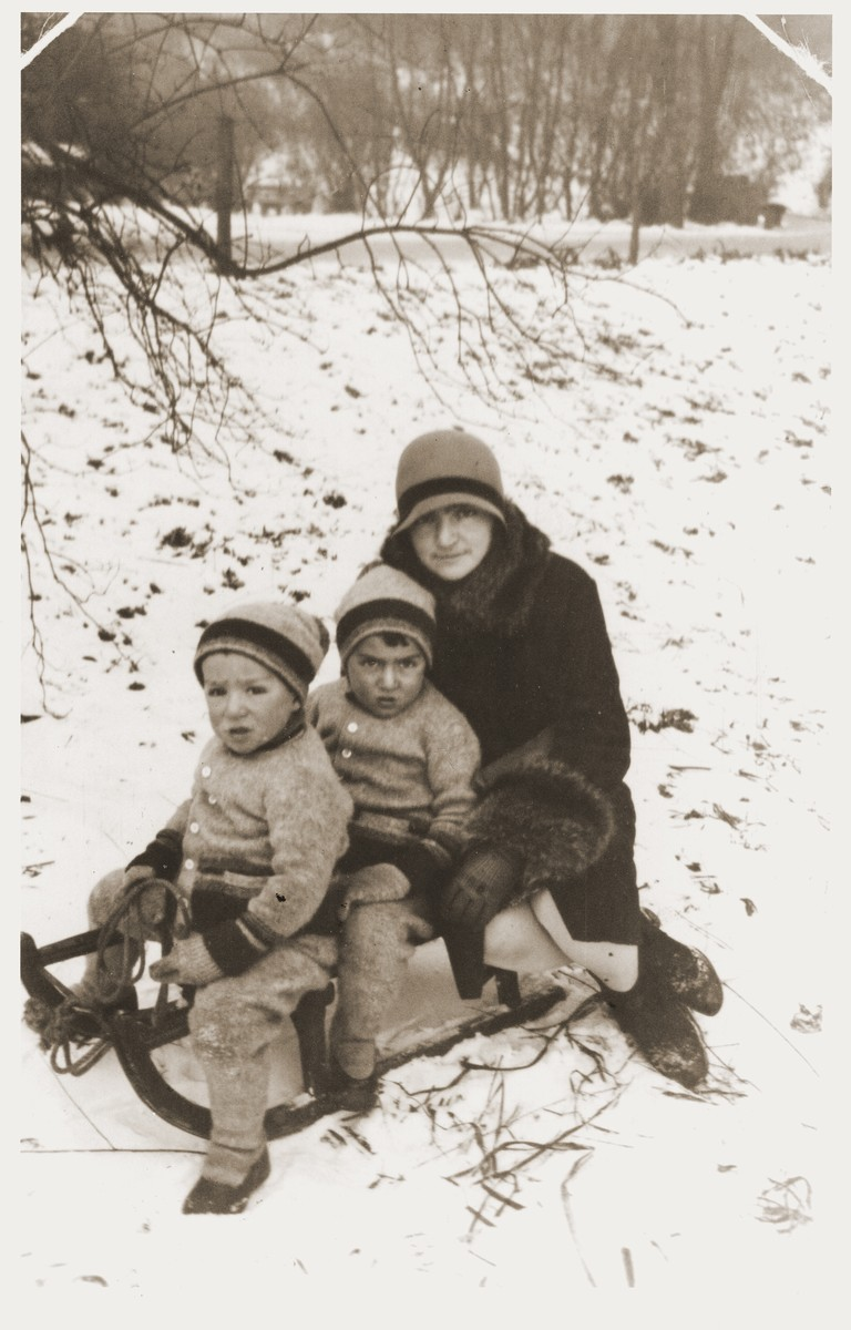 Shulamit Rabinovitch goes sledding with her sons Amos and Binyamin.