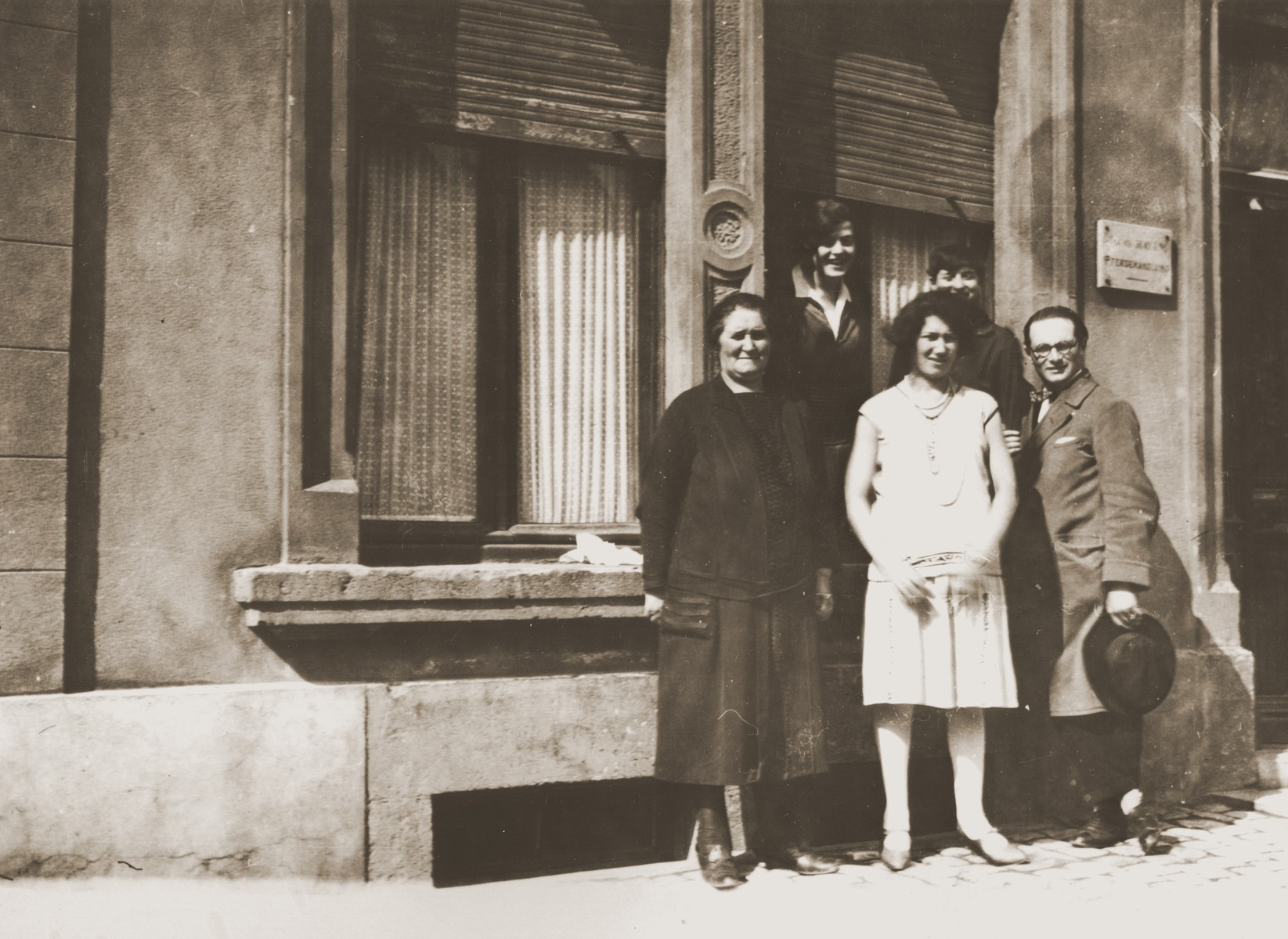 Charlotte Michel poses with members of the Hayum family outside on a street in Luxembourg.    The Hayums were cousins of Jakob Michel.