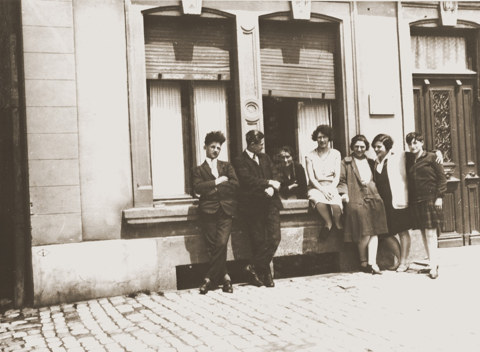 A group of young Jewish men and women pose outside on a street in Luxembourg.  Among those pictured are Charlotte Michel and Margo, Gerthe, Charles, Milla and Jose Hayum.  The Hayums were cousins of Jakob Michel.