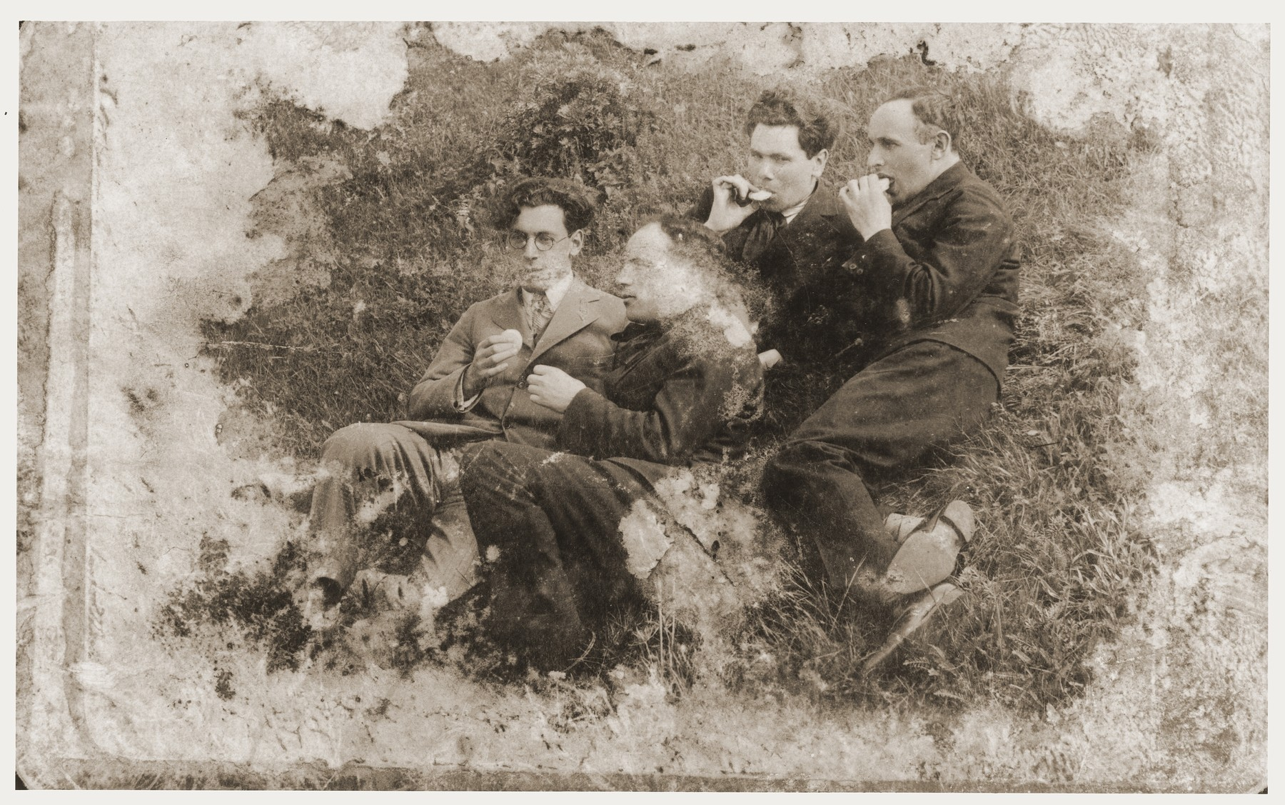 Damaged photograph of a group of friends in Kovno, Lithuania that survived the destruction of the Kovno ghetto.  Among those pictured is the artist Jacob Lifschitz (second from the right).  The photograph was buried with the artist's drawings shortly before the liquidation of the ghetto, and retrieved by his wife after the liberation.