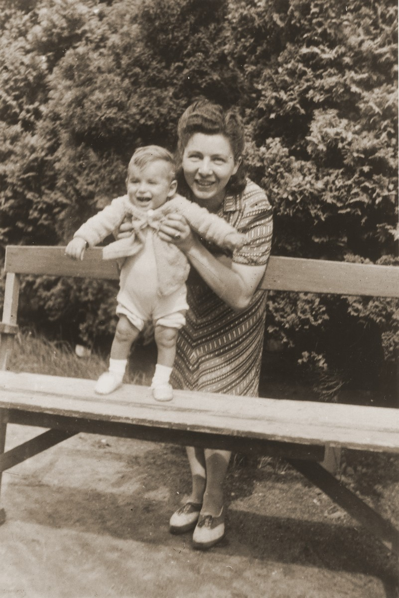 Bertha Gruneberg with her son, Rene, at a park in Boekelo.  The child survived the war, but both his parents were killed.