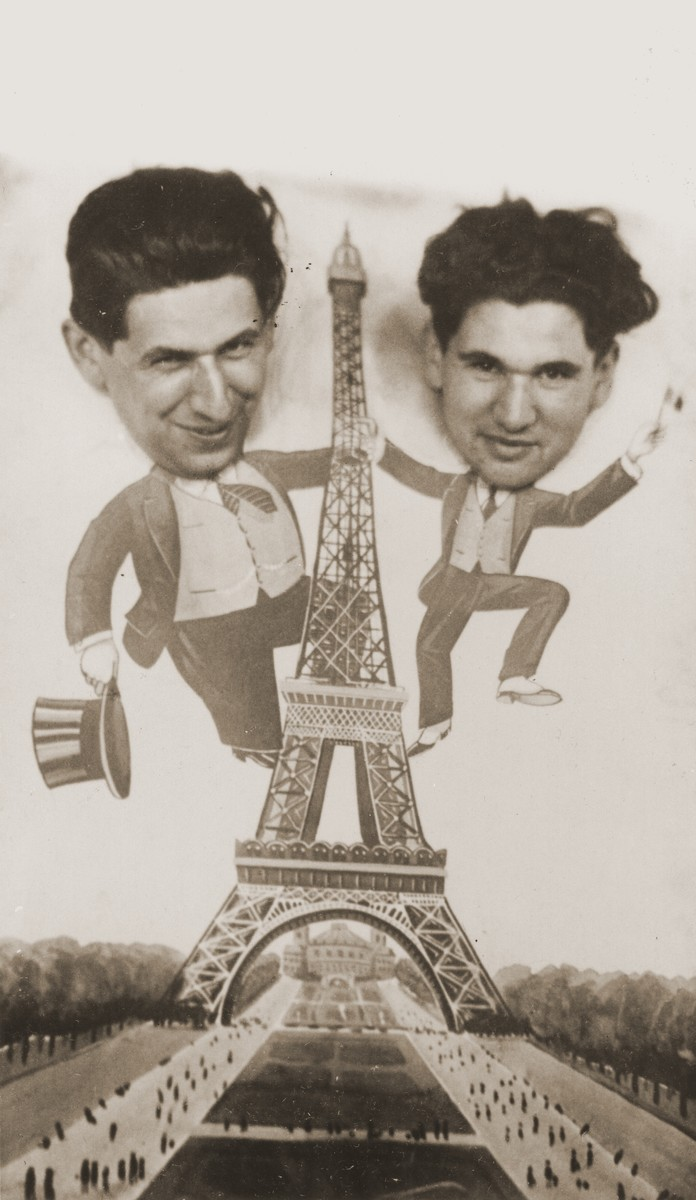 The Zion brothers of Eibergen, Holland pose in a cut out of an Eiffel Tower scene during a vacation in Paris.  This photo was later published in an advertisement for their clothing store in the local Eibergen newspaper.