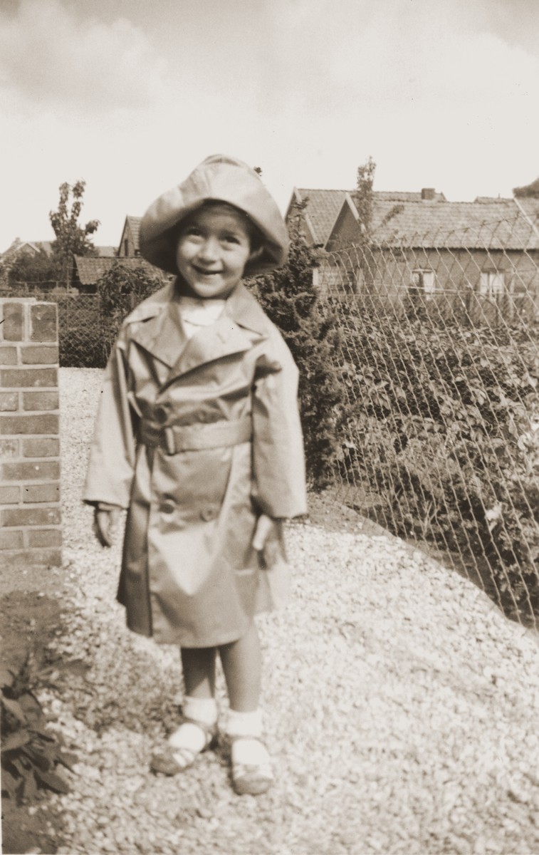 Suse Grunbaum poses in a raincoat one year after her family's arrival in the Netherlands.