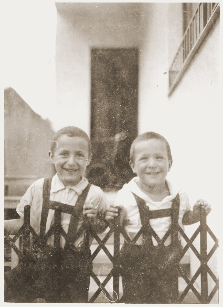Amos and Binyamin Rabinovitch in front of their home in Kaunas.