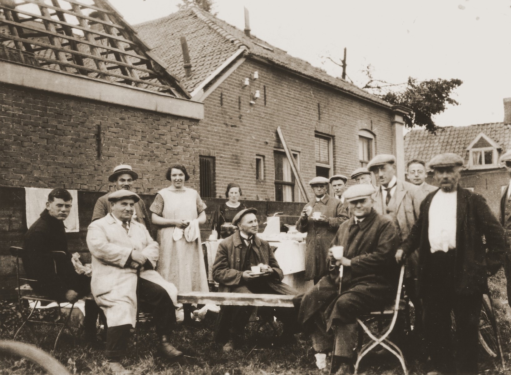 Jewish cattle dealers and Dutch farmers at an outdoor gathering in the vicinity of Boekelo.  Among those pictured are Na Meijer Berg (standing in the center at the back); Leon Berg (second from the left in the light coat); and Joseph Meijer (partially hidden in the back, third from the left).