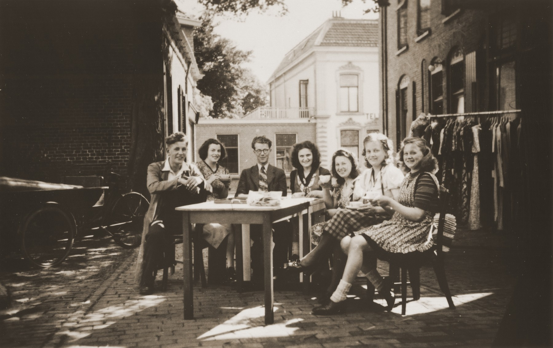 Bep Menco (center) and co-workers at the Zion store enjoy a coffee break in the courtyard behind the business.