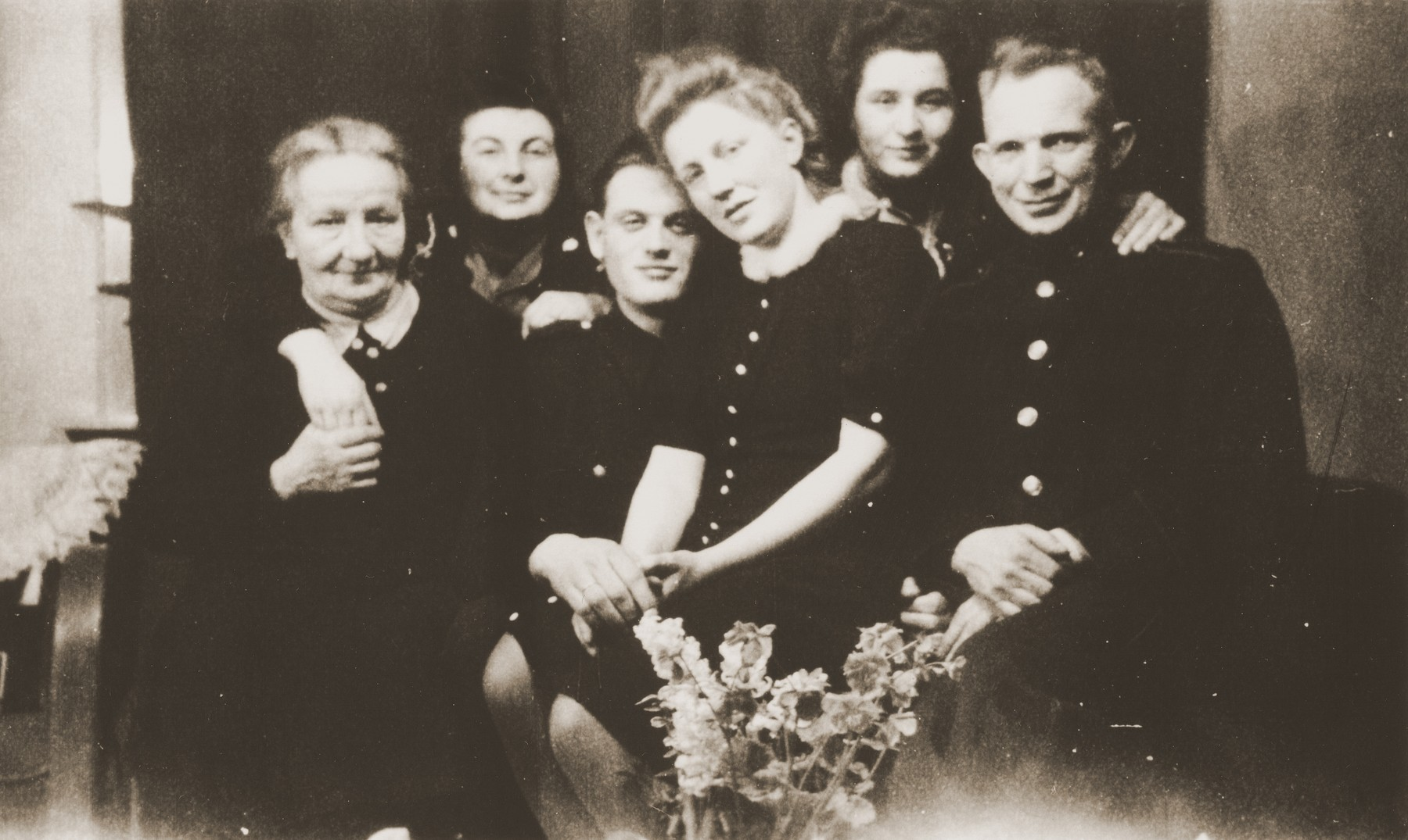 Two Jewish women, who were hidden by the Leuverink family during the war, pose with their rescuers on the occasion of the engagement of their children, Zus and Gerbrandt Leuverink.  Pictured with the Leuverinks are Renee (Sara) Meijer (second from the left) and Mien Zion (second from the right).