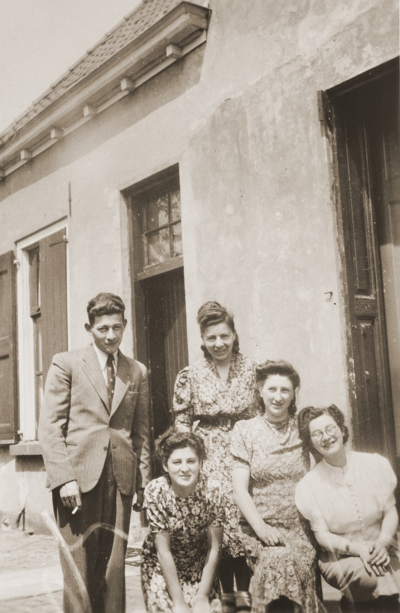 A group of Jewish cousins pose outside the home of Louis Meijer in Boekelo.  Pictured clockwise from the top left are: Horst ? (fiance of Bettie Meijer); Bertha Berg; Bep Meijer; Bettie Meijer; and Sarie Berg.  Horst, Bettie and Bertha perished during the war.